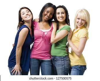 Half length of four young women hugging and smiling