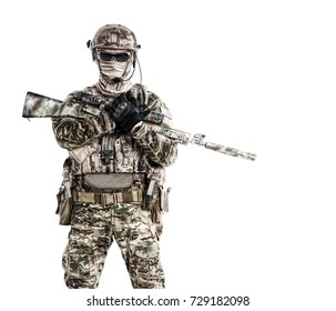 Half length low angle studio shot of special forces soldier in field uniforms with weapons, portrait isolated on white background. Protective goggles glasses are on