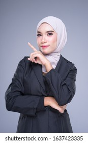 Half length portrait of an attractive Muslim businesswoman wearing hijab with mixed poses and gestures isolated on grey background. For image cutout for corporate, technology, business or finance.