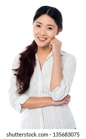 Half length portrait of smiling asian girl isolated over white background.