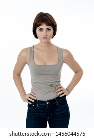 Half length Portrait of young attractive frustrated caucasian woman with angry and serious face. Looking mad and disappointed making gestures in anger. Copy space. Facial expressions and emotions.