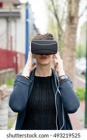 Half length of young beautiful caucasian business woman using 3D viewer - futuristic, technology concept