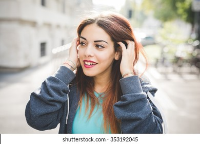 Woman tucking hair behind ear