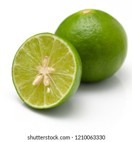 Half of lime citrus fruit (lime cut) isolated on white background