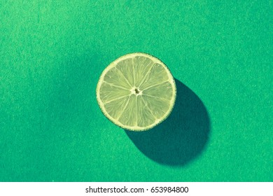 Half of a lime on green
