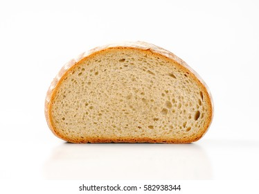 Half a loaf of continental bread, front view