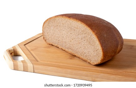 Half a loaf of rye bread lies on a wooden board. Isolated on a white background.