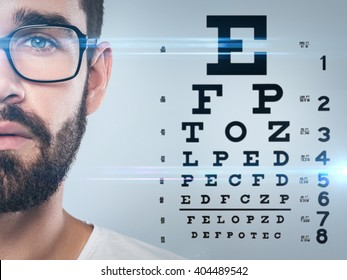 Half of male face and eye chart on background