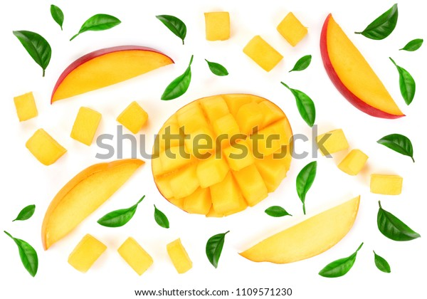 half of Mango fruit decorated with leaves isolated on white background close-up. Top view. Flat lay