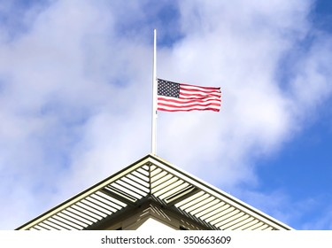 Half mast American flag,  on a cloudy day