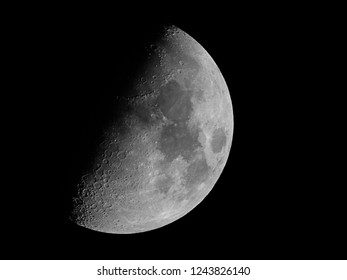 Half moon / The Moon is an astronomical body that orbits planet Earth and is Earth's only permanent natural satellite. It is the fifth-largest natural satellite in the Solar System