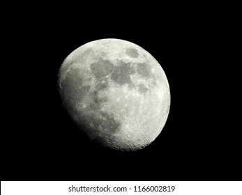 Half moon background / The Moon is an astronomical body that orbits planet Earth and is Earth's only permanent natural satellite