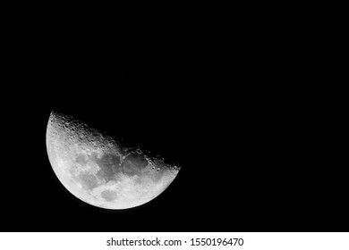 Half moon background / The Moon is an astronomical body that orbits planet Earth.