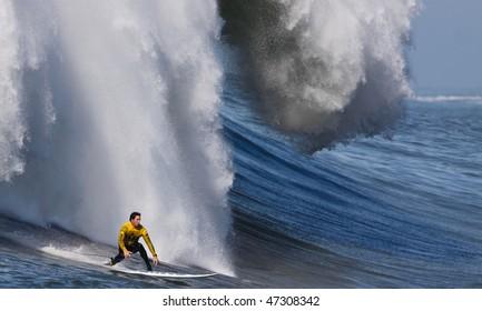 "HALF MOON BAY, CA - FEBRUARY 13: Kenny ""Skindog"" Collins rides a monster wave in the 2009/2010 Mavericks Surf Contest February 13, 2010 in Half Moon Bay, California."