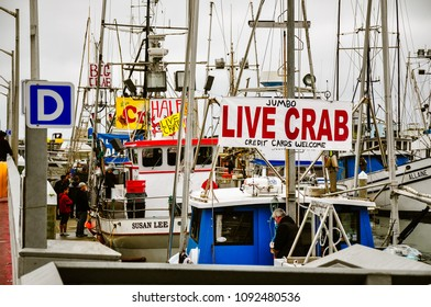 Half Moon Bay, CA/USA - Dec. 7, 2014: It's crabbing season and fishermen are selling their catch from their fishing boats at Pillar Point Harbor.