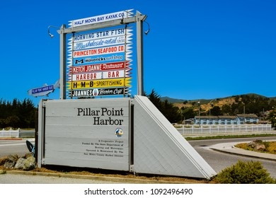 Half Moon Bay, CA/USA - Jun. 7, 2014: Business signs at entrance to Pillar Point Harbor, Half Moon Bay, CA.
