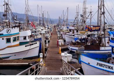 Half Moon Bay, CA/USA - Nov. 19, 2018: Fishing boats docked at the Pillar Point Harbor, Half Moon Bay, CA.