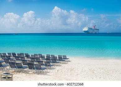 "HALF MOON CAY, BAHAMAS ISLANDS - 14:00. February 27, 2017: Carnival ""Fantasy"" cruise ship tendered next to the tropical island. Over 3,500 guests went out to visit beautiful  beach."