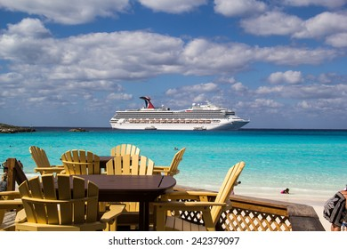 HALF MOON CAY, BAHAMAS-NOVEMBER 2: The Carnival Glory cruise ship is anchored offshore in Half Moon Cay on November 2, 2014. Half moon cay is is an island owned by cruise lines with beautiful beaches.