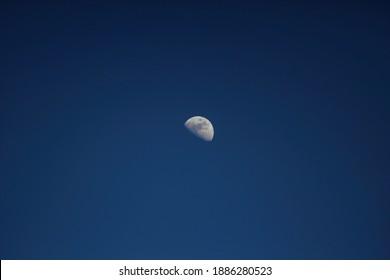 half moon during daylight ,