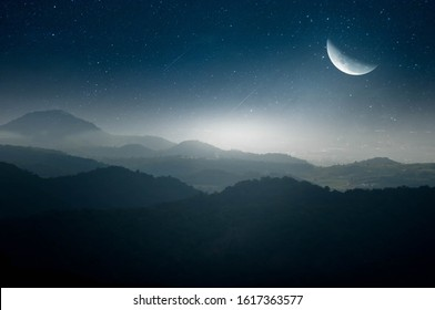 Half moon fluttering in the middle of the mountains on a beautiful night.