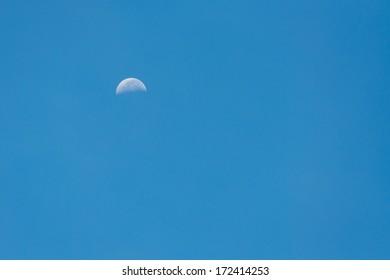 half moon on a blue sky