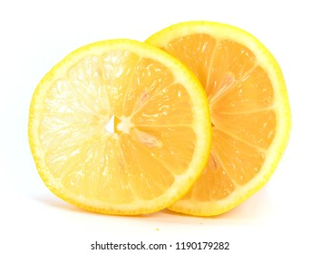 Half and one slice of lemon close-up isolated on white background