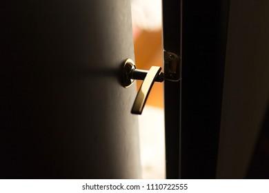 Half open door of a hotel bedroom or apartment