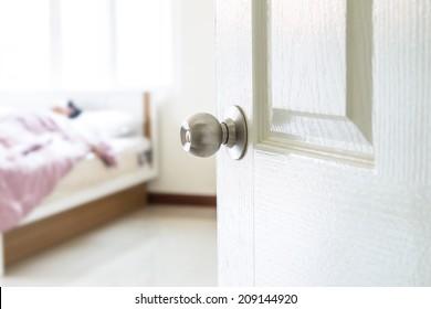 half opened bedroom door which have someone sleeping