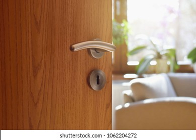 Half opened door into the cozy home interior