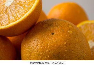 half of orange fruit  on white