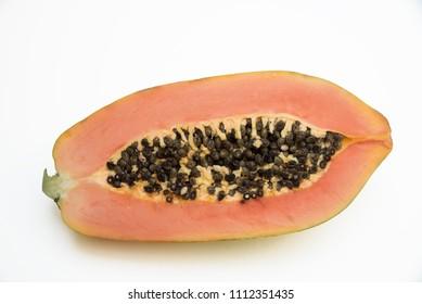 half of a papaya fruit with black seeds, isolated on white background