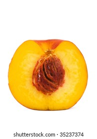 Half peach isolated on white, close-up