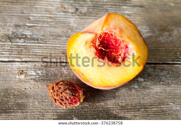 Half peach and stone from the peach