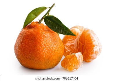 Half of a peeled mandarin next to whole mandarine with leaves isolated on white. Broken segment.