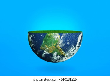 Half of the planet Earth with grass on a blue background. The concept of the ecology of the planet