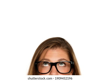 Half portrait of a young puzzled woman with eyeglasses on a white background