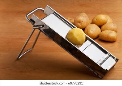 Mandolin Slicer Images, Stock Photos & Vectors | Shutterstock