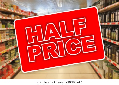 Half price red label on a blur Supermarket background