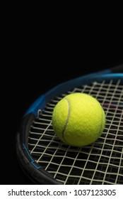 Half a racket and a tennis ball
