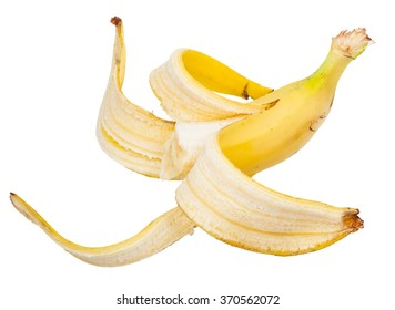 half ripe banana in the peel isolated on white background