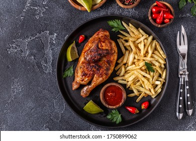 Half roasted chicken Piri Piri with french fries, top view