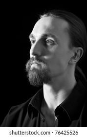 half section portrait of bearded man, low key