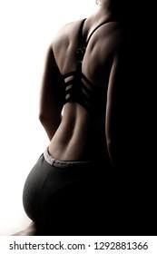 half silhouette of beautiful caucasian's girl back in sportswear