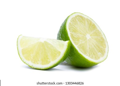 Half with slice of fresh green lime isolated on white background. Citrus