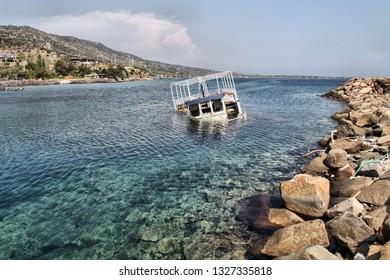 A half submerged fisherman boat is in Sokakagzi bay, Aegean Sea