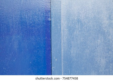 Half and Half textures - 2 shades of blue painted hoarding