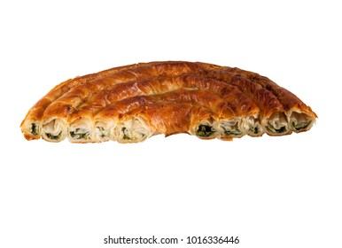 Half of the traditional turkish spinach pie isolated on white. ispanak yufka with goat cheese.