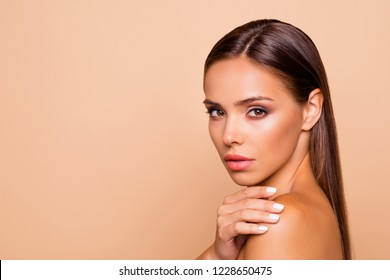 Half turn close up photo of brown-haired beautiful lovely pretty lady touch her naked shoulders she isolated on pastel beige background with copy space for text
