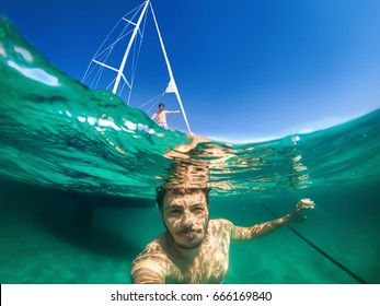 Half underwater selfie infront of boat, happy summer time with firend.